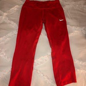 Reddish/coral Nike crop workout leggings